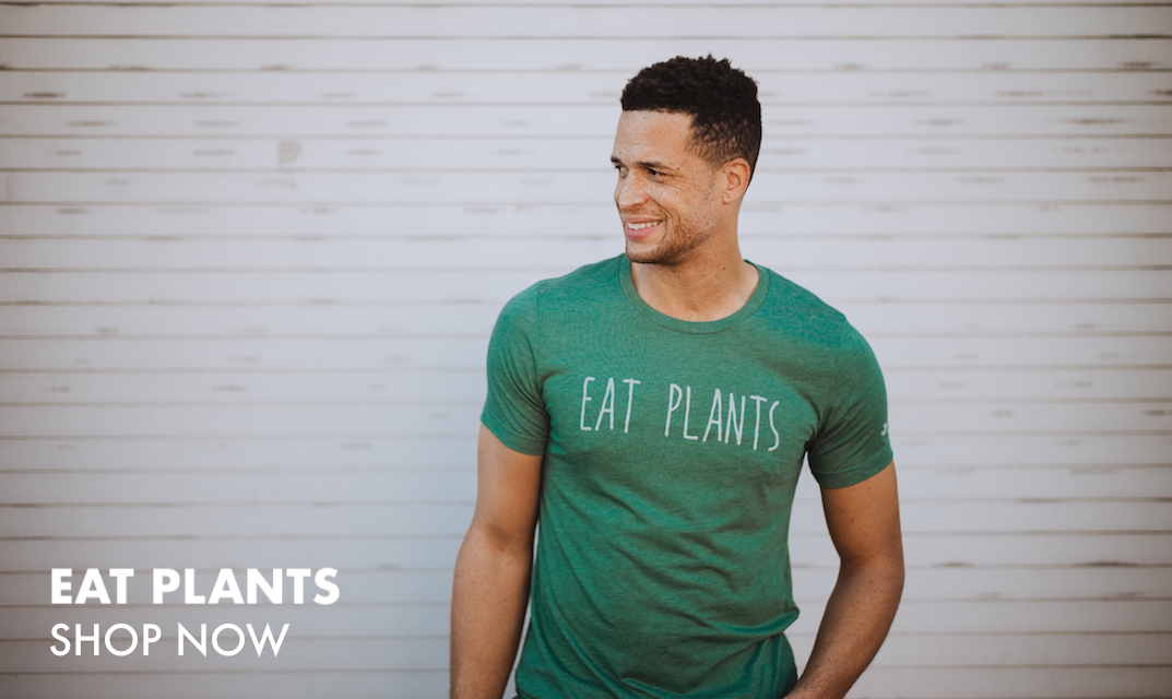 This is a photo of a man wearing a green shirt that says Eat Plants. Click this image to view our Eat Plants items.
