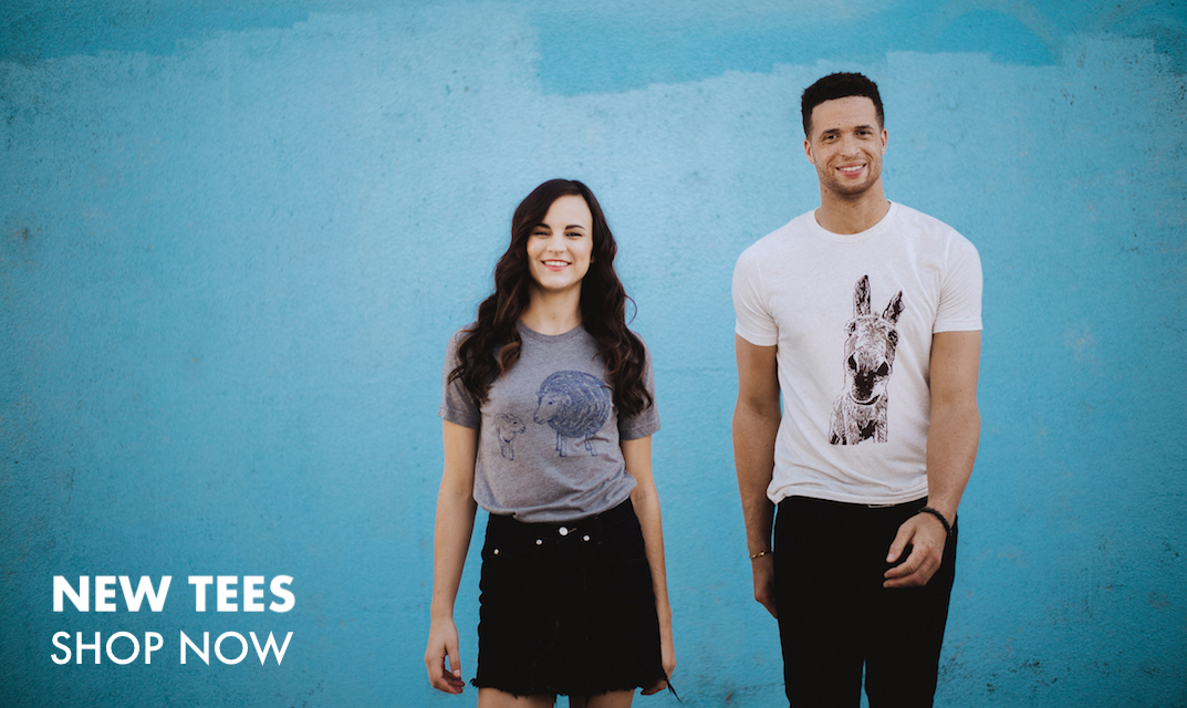 This is an image of a man and woman each wearing a t-shirt featuring a Farm Sanctuary resident. Click to shop new tees.