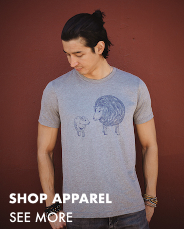 This is an image of a man wearing a t-shirt featuring a line drawing of sheep. Click to go to all apparel.